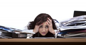 14003-woman-overworked-paper-hide-sad-stress-office-wide.1200w.tn