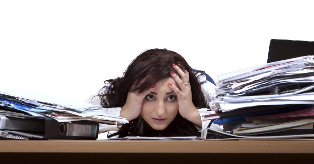 14003-woman-overworked-paper-hide-sad-stress-office-wide.1200w.tn