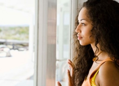 Blackwoman-looking-out-window